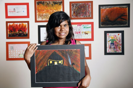 Netty Atkinson with her painting, 'The Disaster'