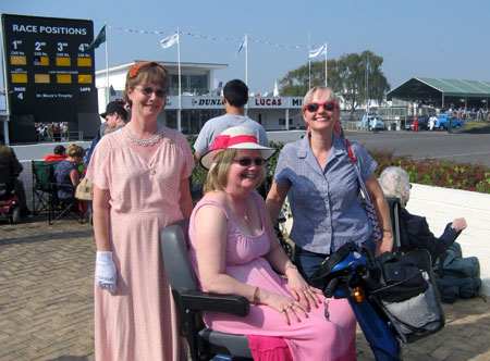 Three sisters, who had chosen to dress in accord with Goodwood Revival's theme, spending time in 'another world'