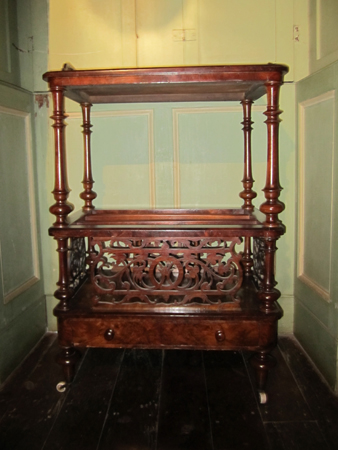 Walnut canterbury with foliate scroll decoration