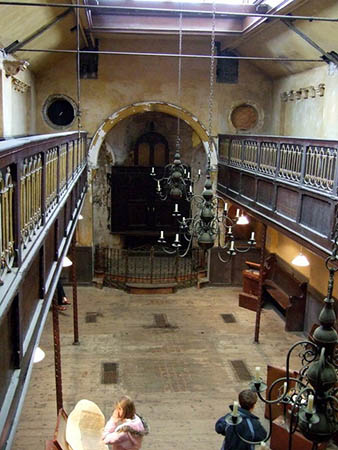 The main area of what was once the old synagogue, viewed from the gallery, with some of the exhibits in the Suitcases and Sanctuary exhibition