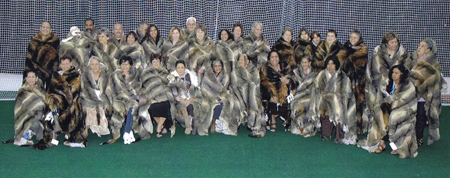 Elders and community representatives from 35 Victorian language groups in possum-skin cloaks for the opening ceremony, Commonwealth Games, Melbourne, March 2006.