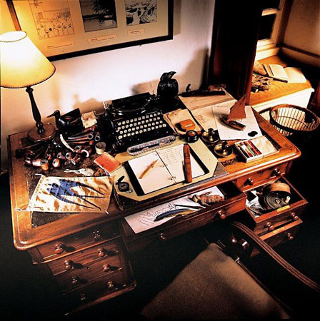 The display based on the table that Arthur Ransome inherited from his mother, including his typewriter, the Russian candle-sticks, writing impedimenta and a selection of his many pipes