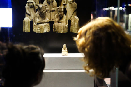 Visitors view the Lewis chess king