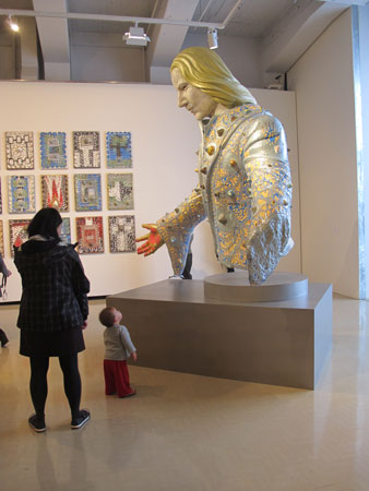 Toddler Jimmy studying Apocalyptic Intuition, a work by artist Rohan Wealleans, during a Gallery Babes session at the City Gallery, Wellington