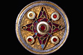 Wingham brooch, 575–625  silver-gilt, niello, garnet, glass and shell, England