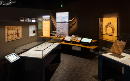 The 'Encounters with pastoralists' module features an 1870s dulloom or woven bag collected from the Bundjalung people of Richmond River (far right); on display at the National Museum of Australia, 2015–16