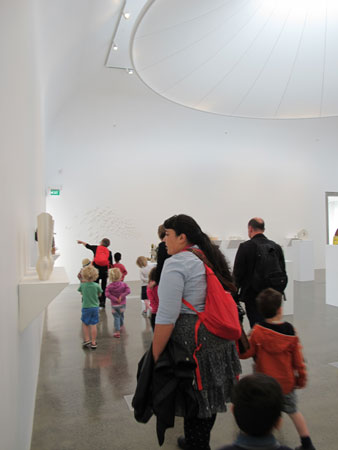 Teachers, student teachers, parents, and grandparents help to support children's engagement with art works on a successful self-guided visit to the Te Uru Waitakere Contemporary Gallery, Auckland (2015)