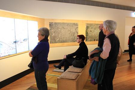 Visitors watching the film Creekology, Navigating Norman Creek, Museum of Brisbane 2015