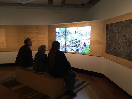 Visitors watching the film Creekology, Navigating Norman Creek, Museum of Brisbane, 2015