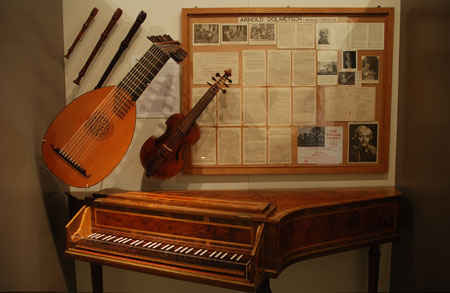 A display of instruments in the Grainger Museum featuring one of Grainger's original 'legends'