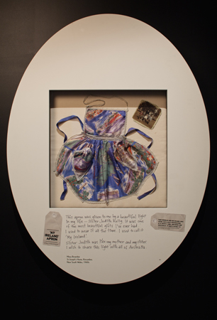 Apron made for Mary Brownlee by Sister Judith Kelly