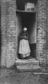 French woman outside her house