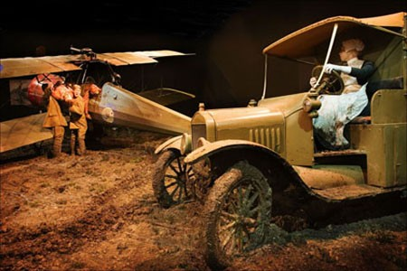 A nurse driving an ambulance in the set piece at Omaka depicting the crew of a Morane-Saulnier being pulled from their aeroplane.