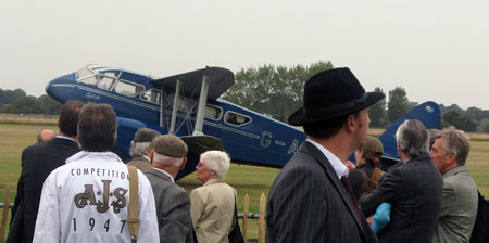 Goodwood Revival's air display — here including one of two 1930s de Havilland Dragon Rapides present — attracts large crowds