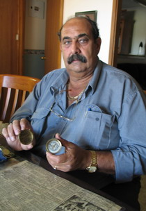 William Bejah holding brass compass