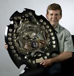 Guy-Hansen-with-shield_w150
