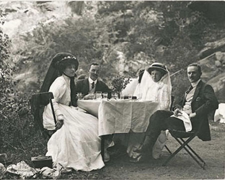 Photo of people sitting at a picnic table.