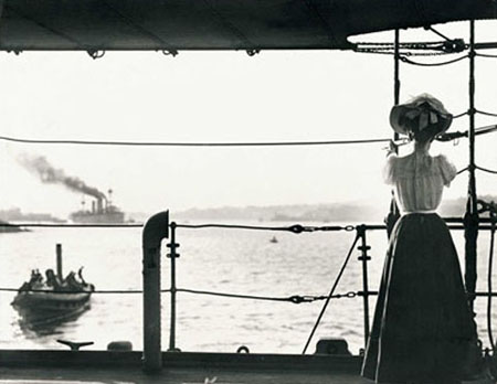 Photo of a woman standing on a boat.