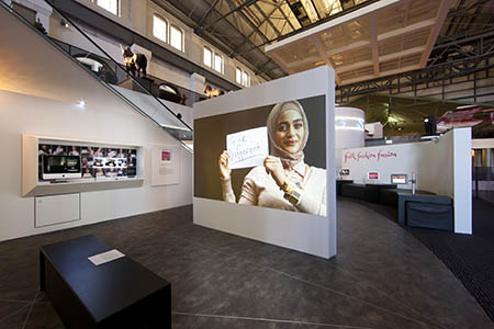 An interactive photo booth where visitors are invited to write something about themselves on a placard and save a photo of themselves to the photo stream – a process that challenges them to examine their own assumptions when judging people based simply on appearance